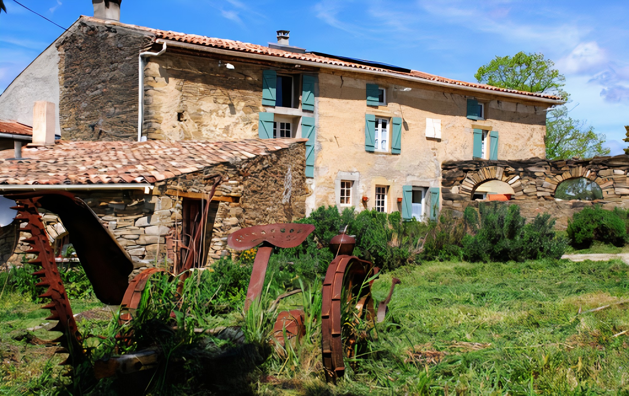 A group of lawn chairs sitting on top of a brick building at Domaine Bellelauze.