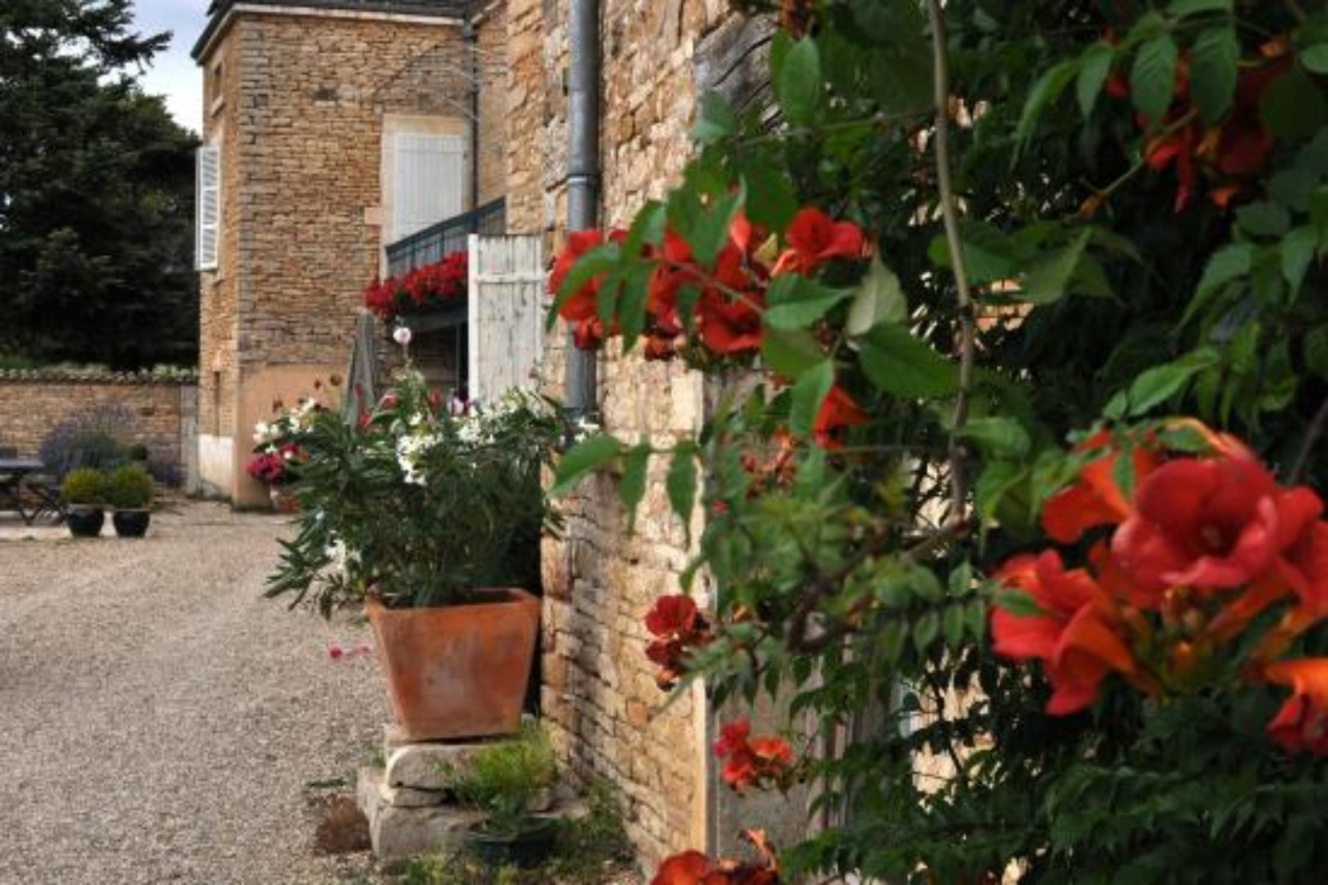 A vase of flowers on a brick building at Le Crot Foulot.