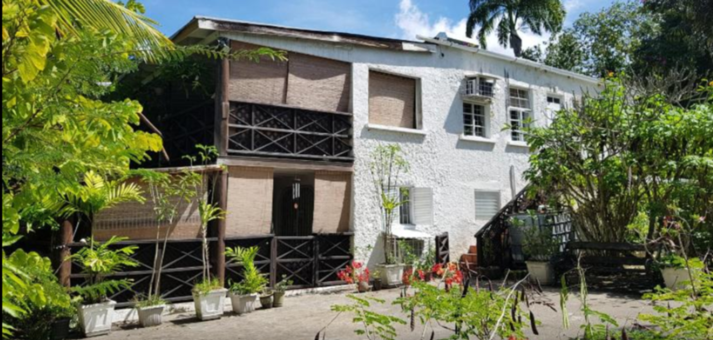 A house with bushes in front of a building at Barbados Chi Centre.