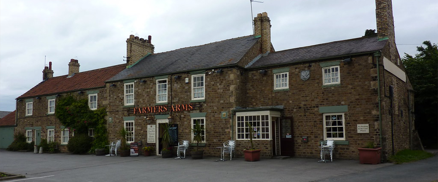 An old brick building at The Farmers Arms.