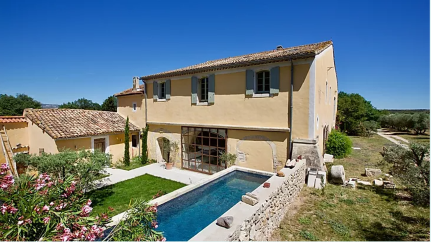 A large lawn in front of a house at La Tauliere.