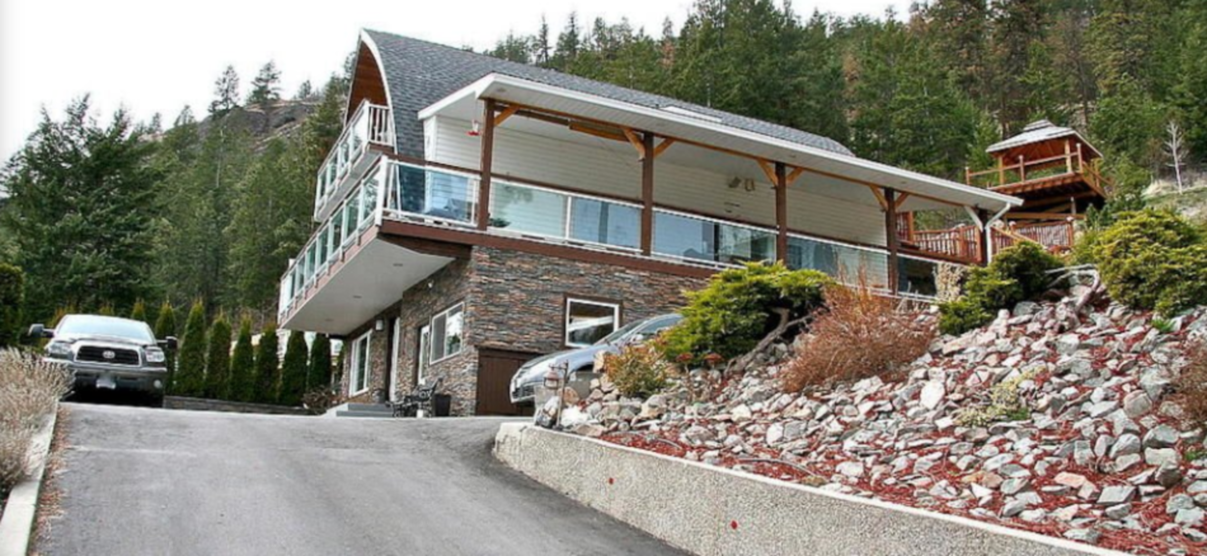 A person riding a skateboard up the side of a building at Chez Nicole Bed and Breakfast.