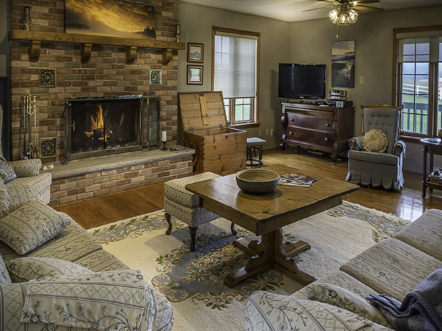 A living room filled with furniture and a fire place at Mountain Ash Farm Hospitality .