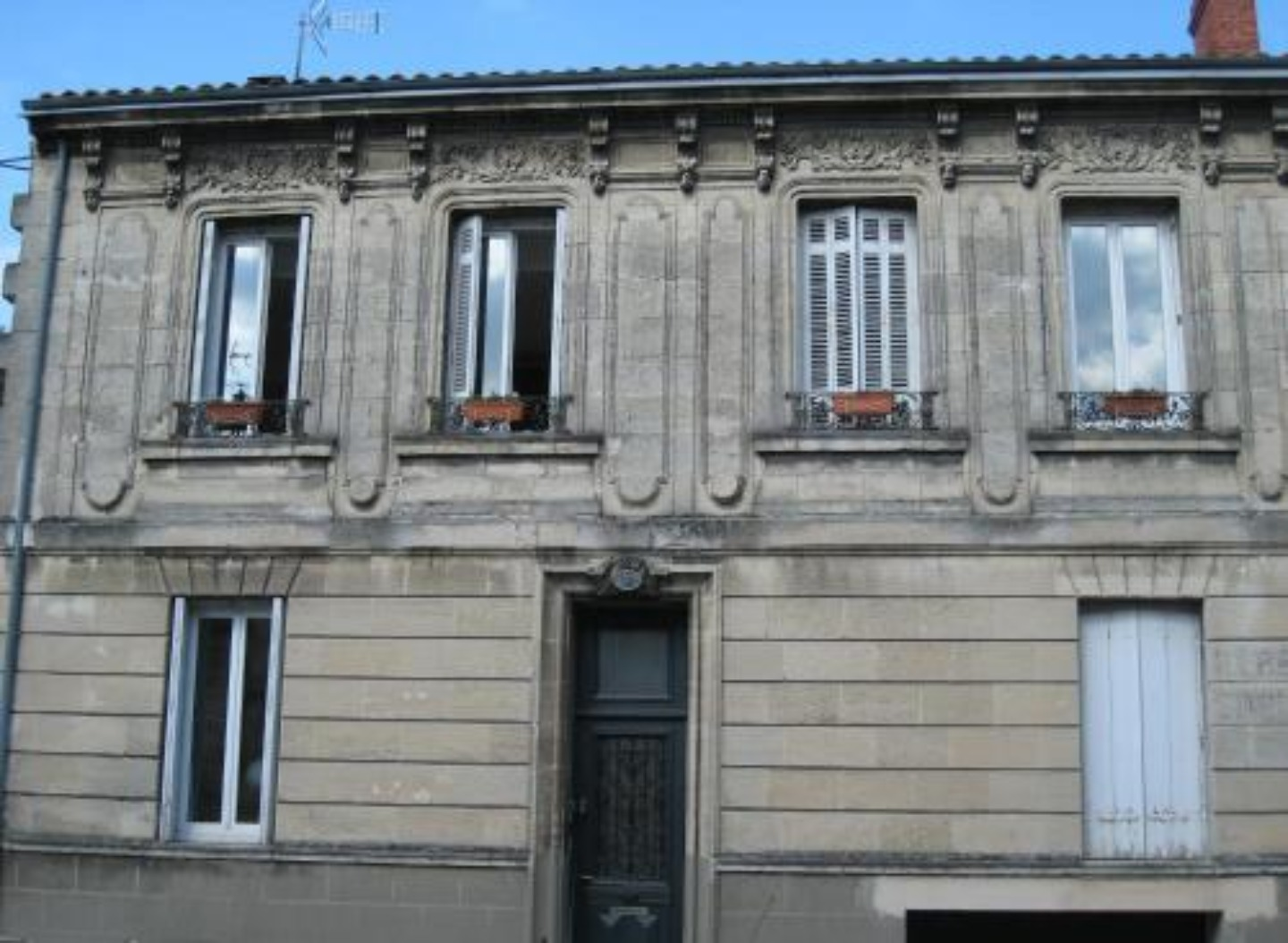 A person standing in front of a building at La Maison Bastide.