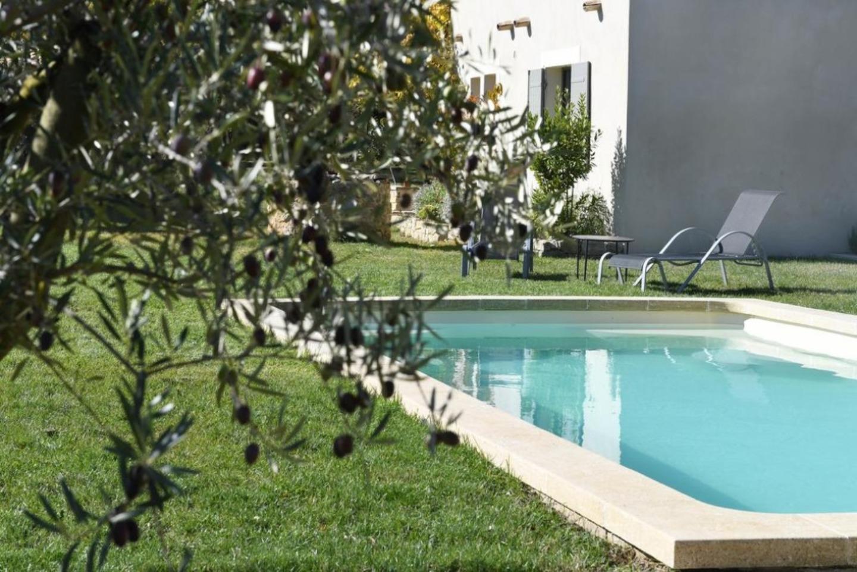 A large pool of water at La maison de Bécaras au pied du Mont Ventoux.