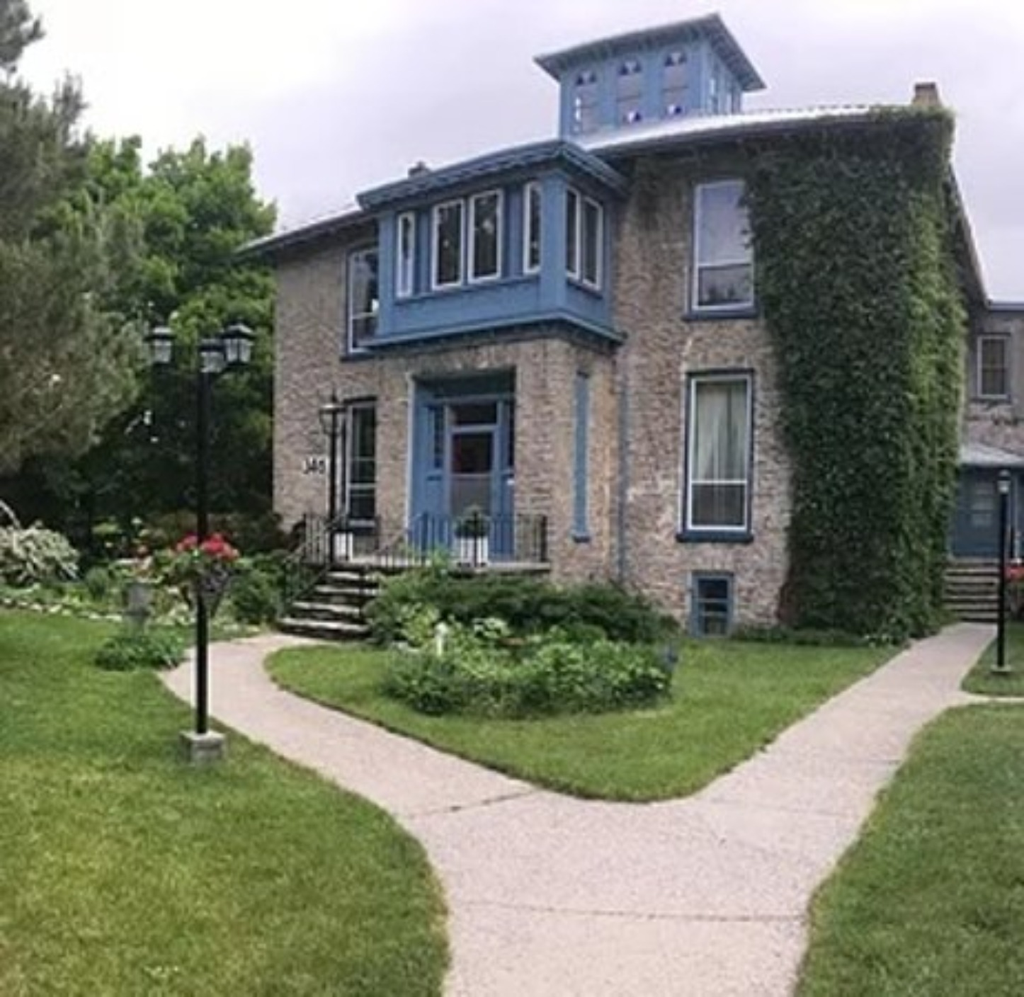 A large lawn in front of a house at English Rose Spa & Holistic Healing Centre.