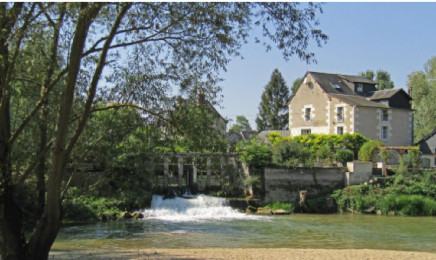A bridge over a body of water at Le Moulin de Saint Jean.