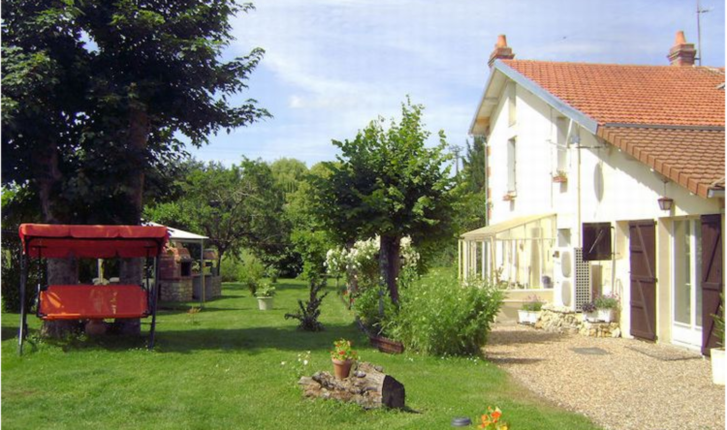 A large lawn in front of a house at LE PRE VERT.
