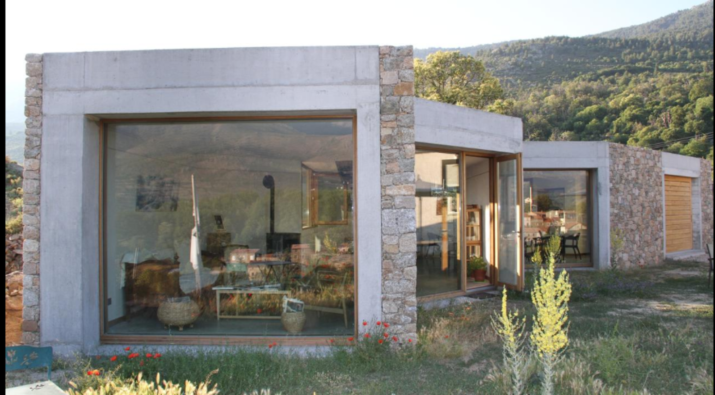 A fire place sitting in front of a house at Casa Vanella.