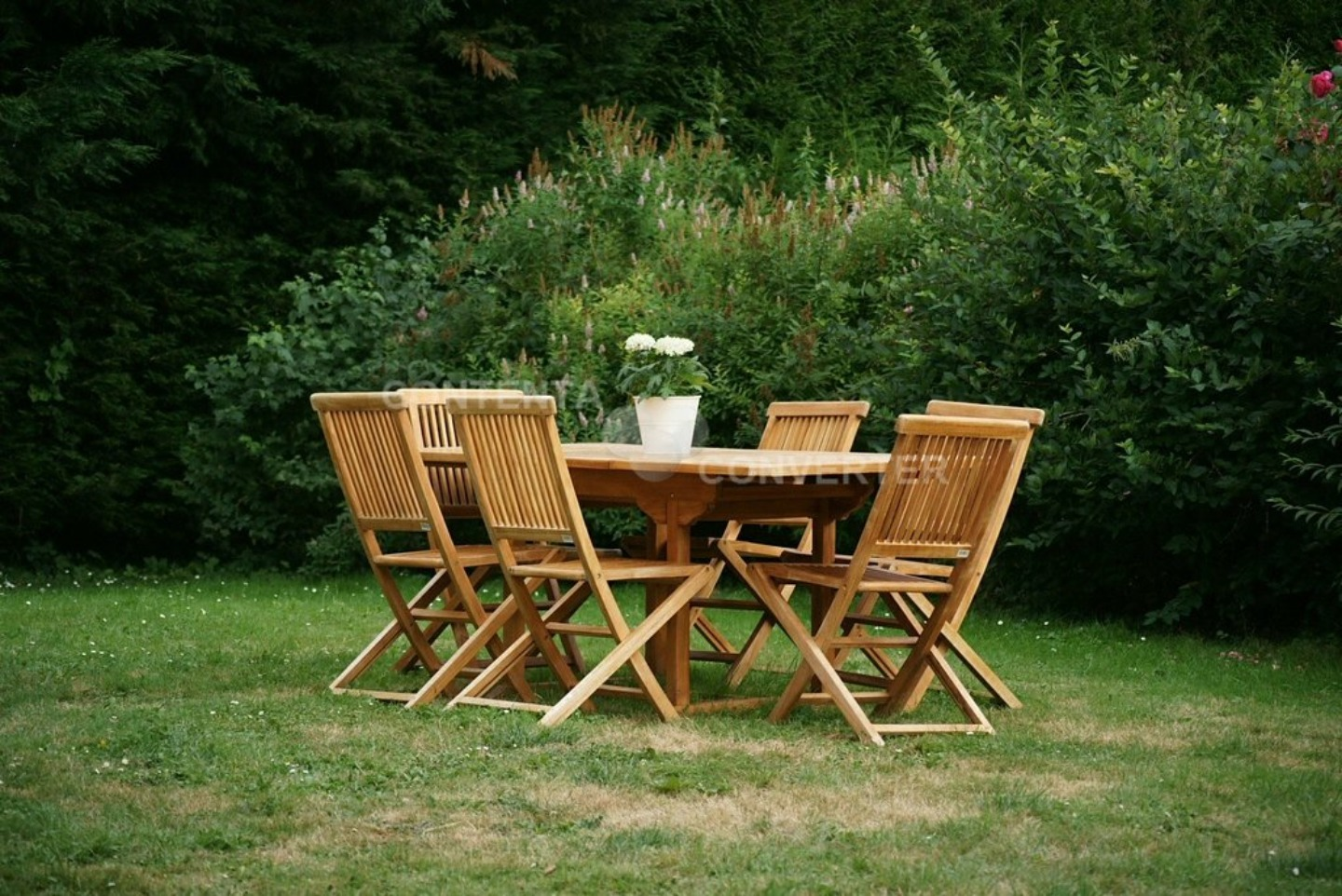 A couple of lawn chairs sitting on top of a wooden chair at Le gite du Tau.