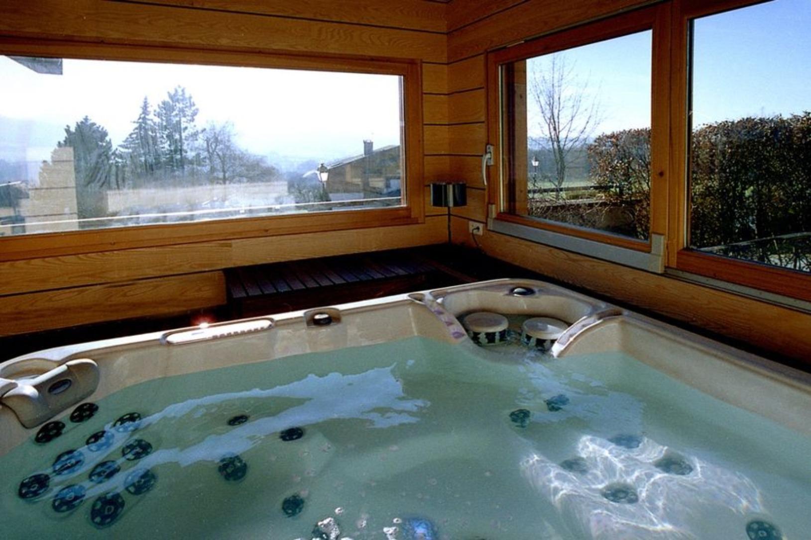 A large tub next to a window at Les Loges de la Paresse.
