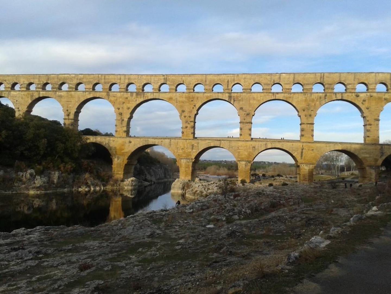 Pont du gard over a river at Atelier de Fons.