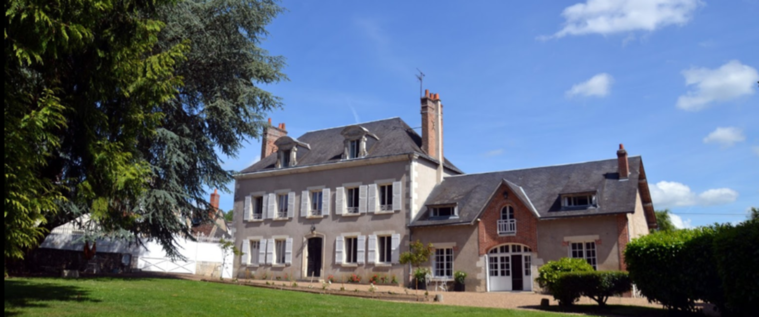 A house with trees in the background at LE CLOS SAINTE-MARIE.
