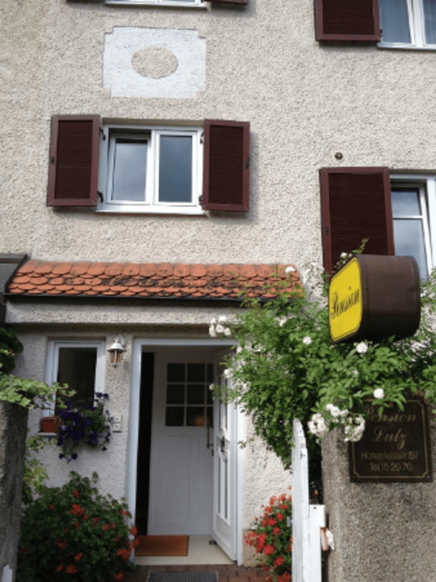 A house that has a sign on the side of a building at Pension Lutz.