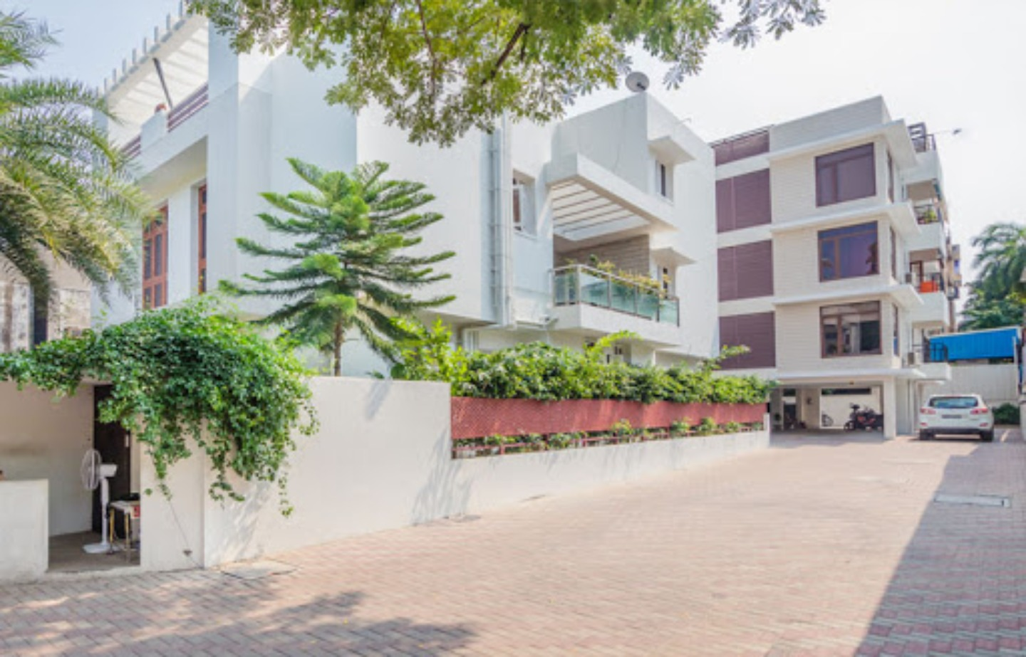 A person standing in front of a building at Kolam Serviced Apartments.