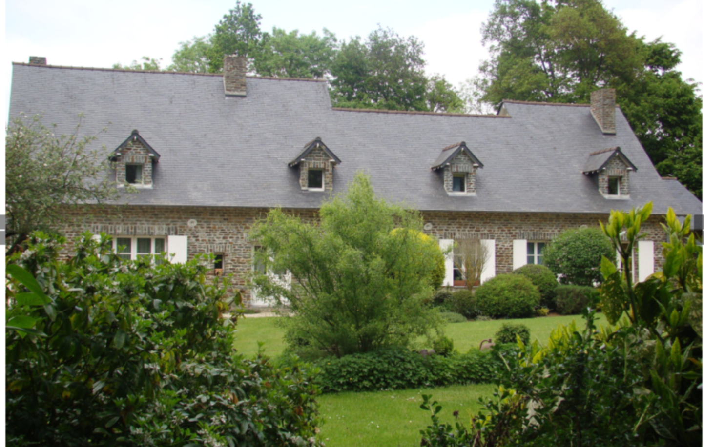 A house with trees in the background at La Bruyère.