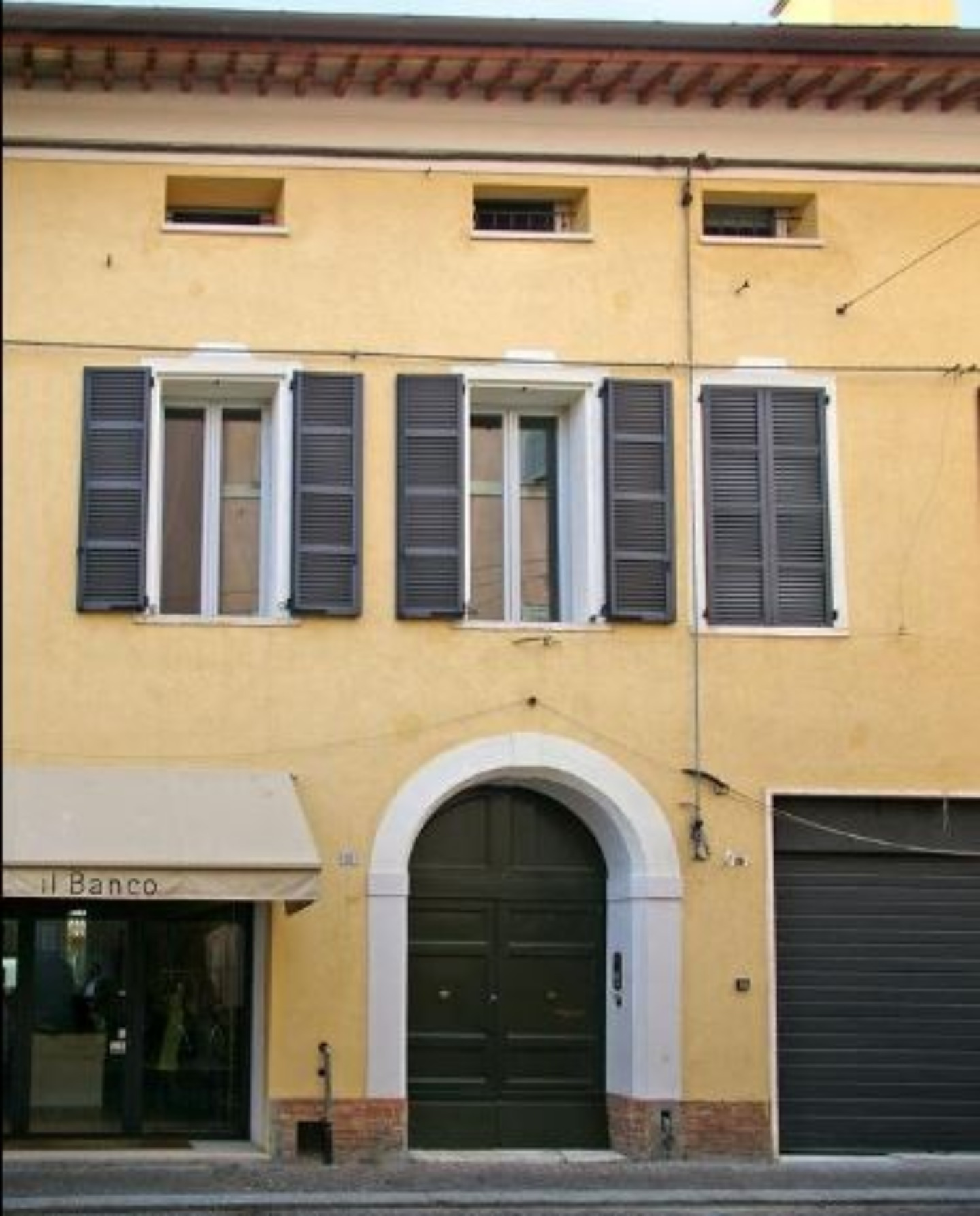 A person standing in front of a building at A Casa di Paola.