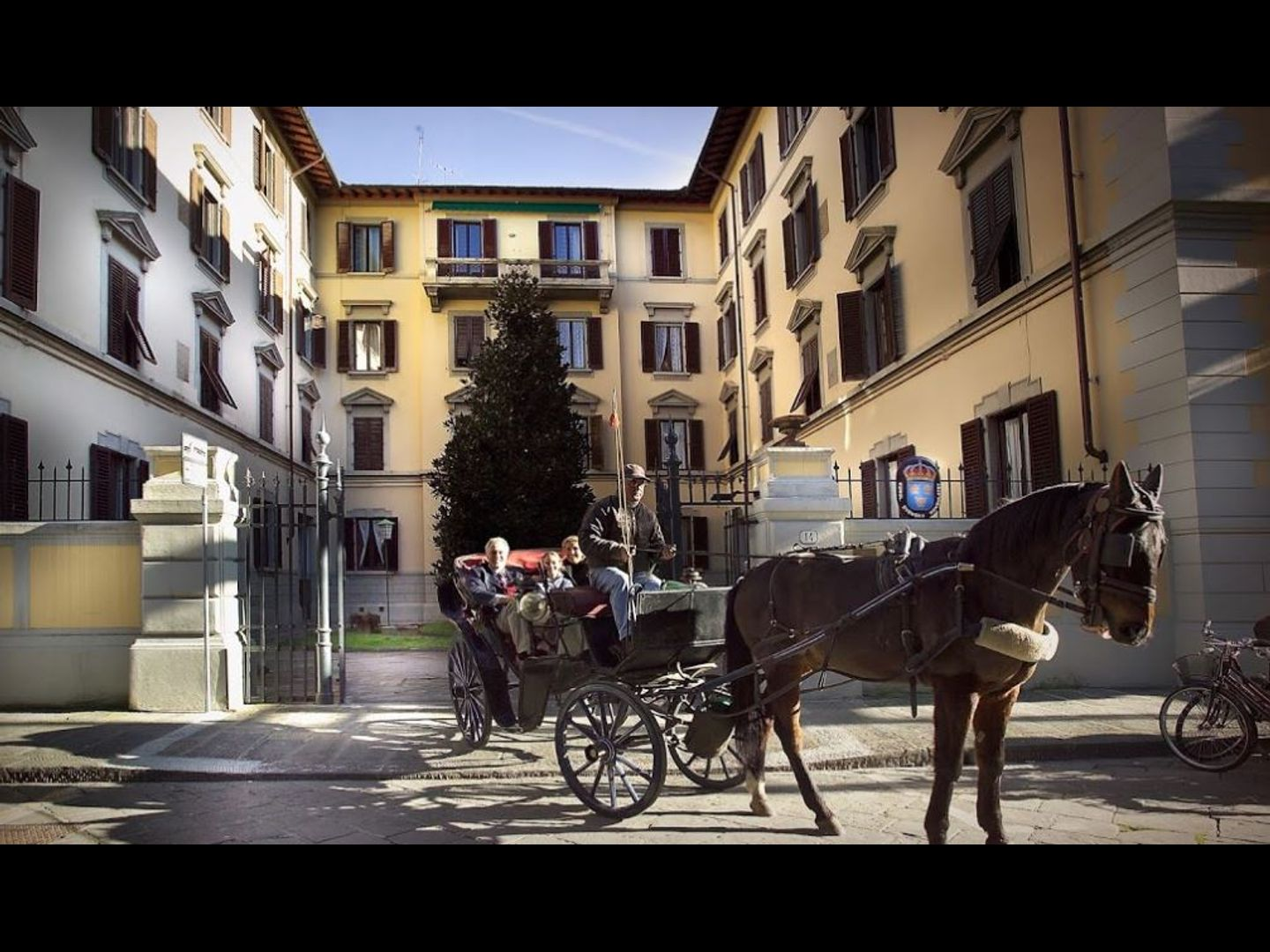 A person riding a horse drawn carriage on a city street at Residenza Johanna I.