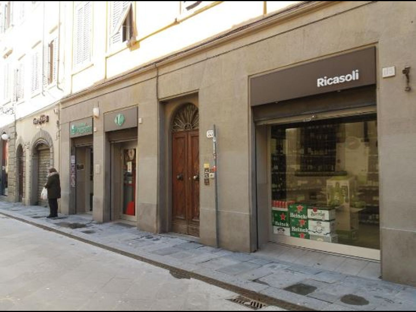 A building with a store on the side of the street at La Locanda dell'Accademia.