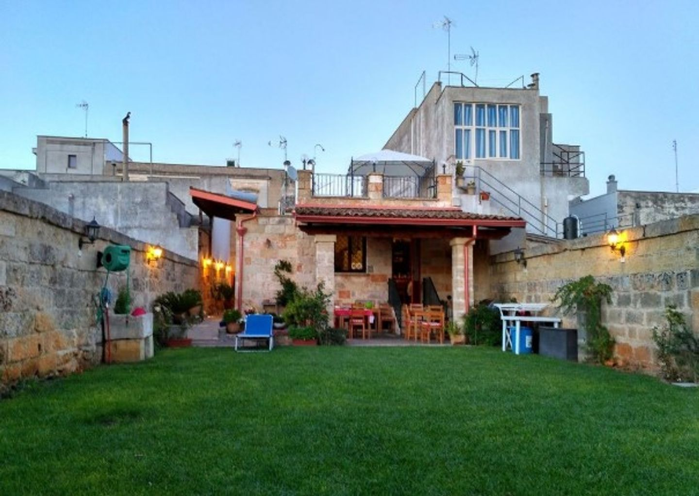 A large brick building with green grass at B&B Incanto.