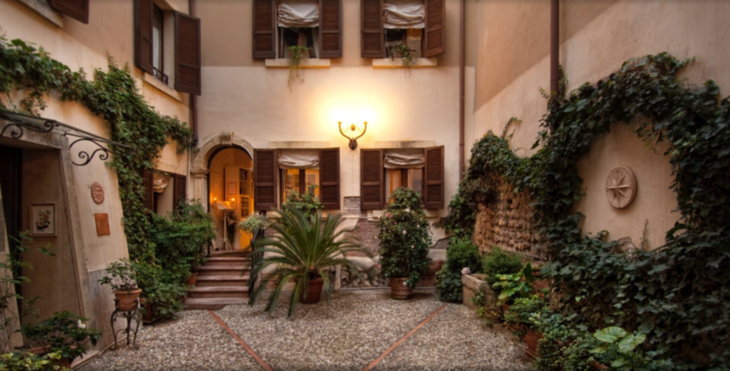 A person standing in front of a building at  Casa & Natura Breviglieri Bed & Breakfast.