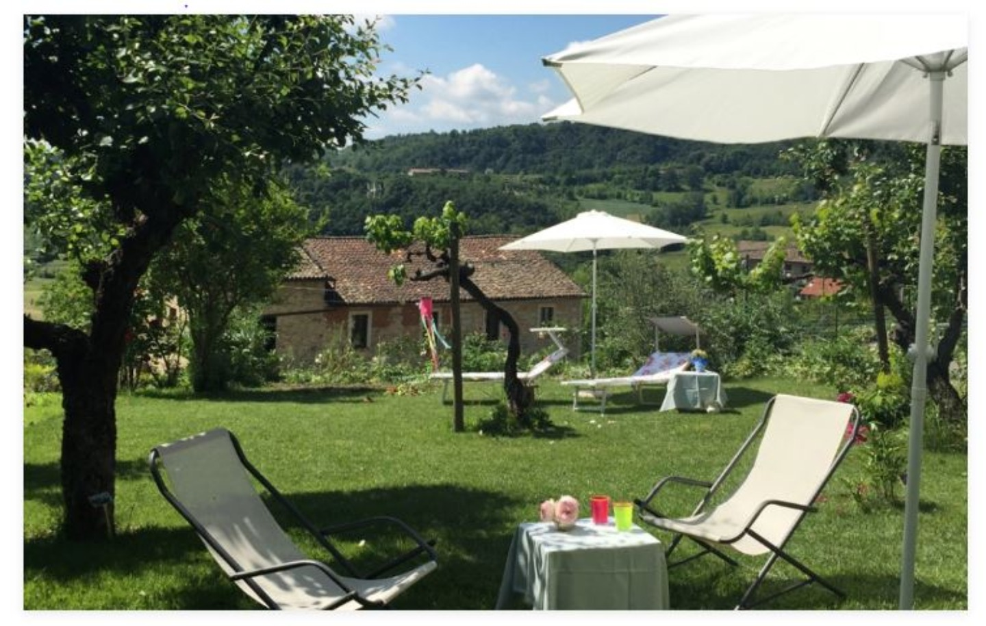 A couple of lawn chairs sitting on top of a picnic table at I Peschi Bed  and Breakfast.