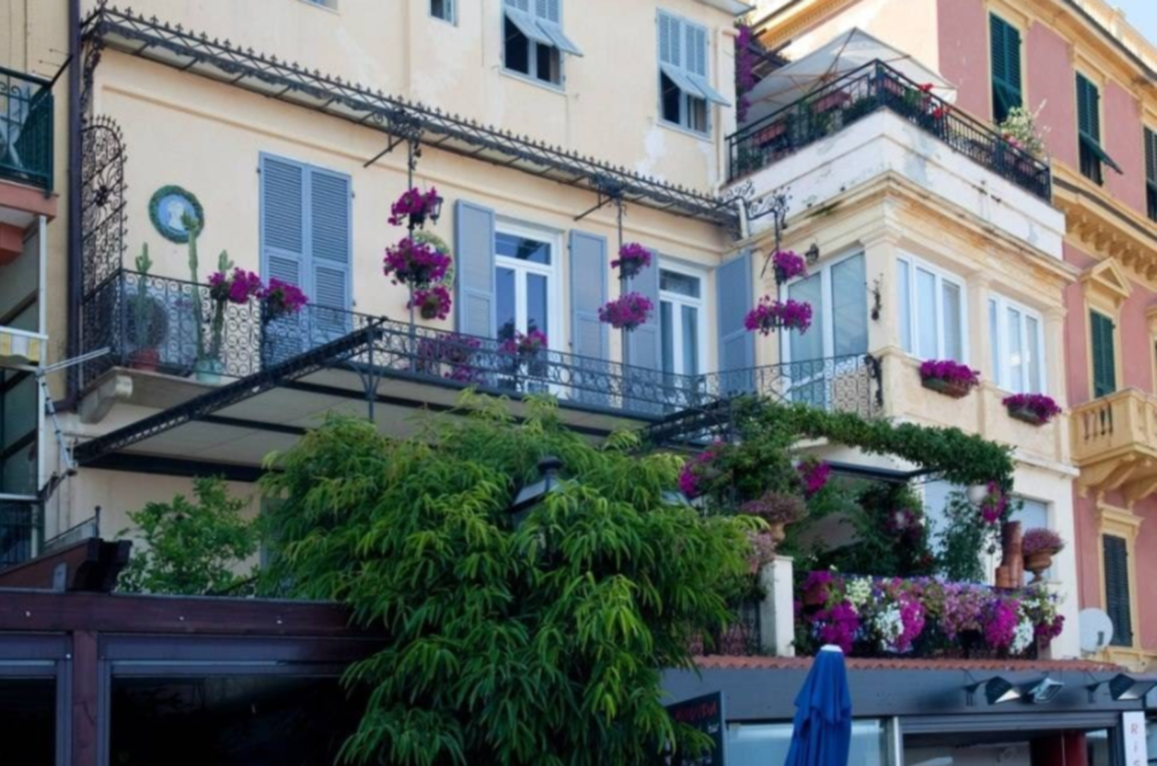 A person standing in front of a building at Bed and Breakfast Il Girasole Alassio.
