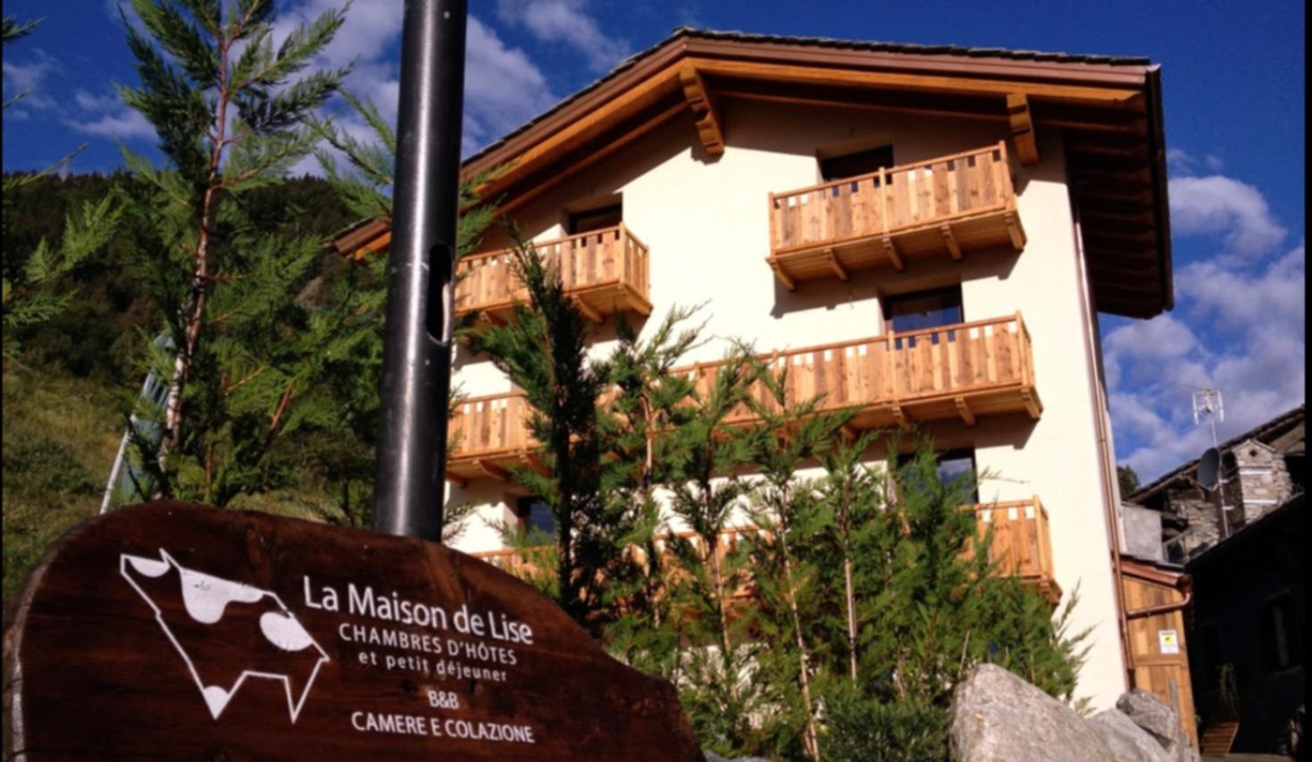 A sign on the side of a building at La Maison de Lise.