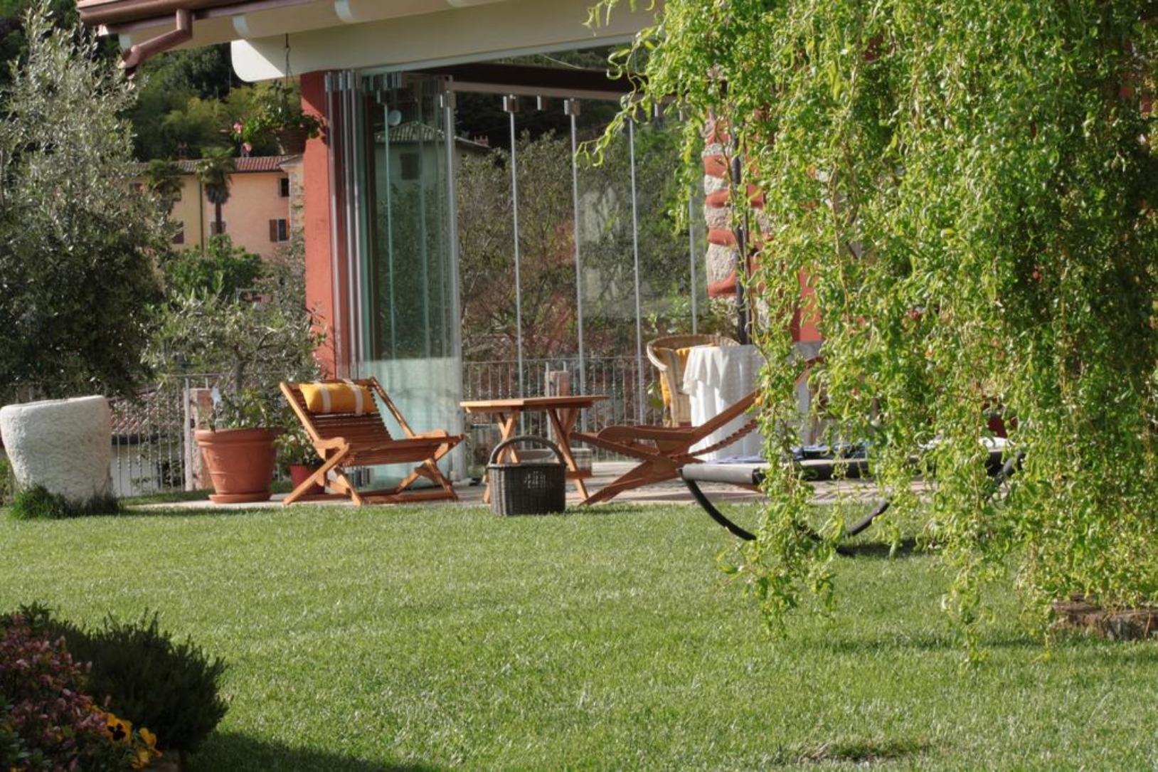 A group of lawn chairs sitting on top of a grass covered field at Poggio Caiar Bed & Breakfast.