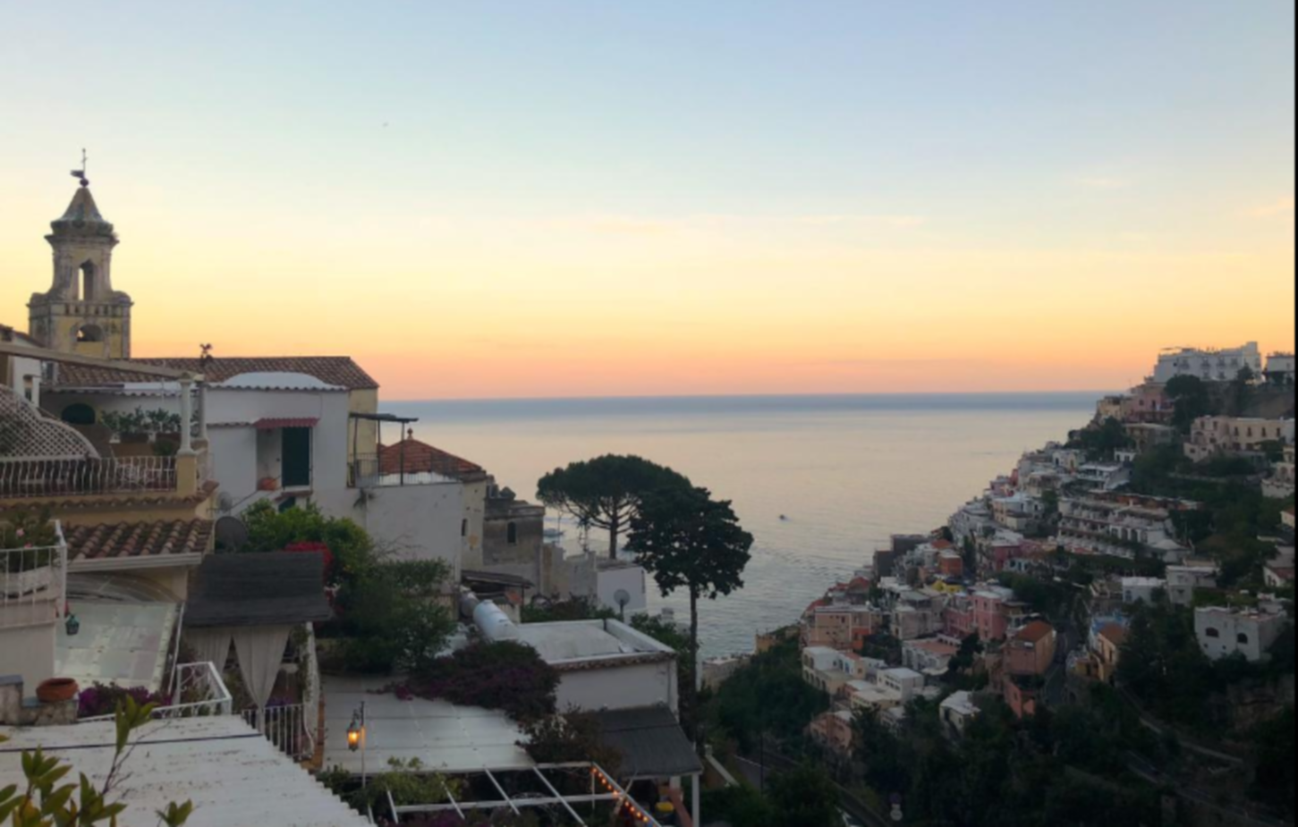 A large body of water with a city in the background at B&B Villa Mary Positano.