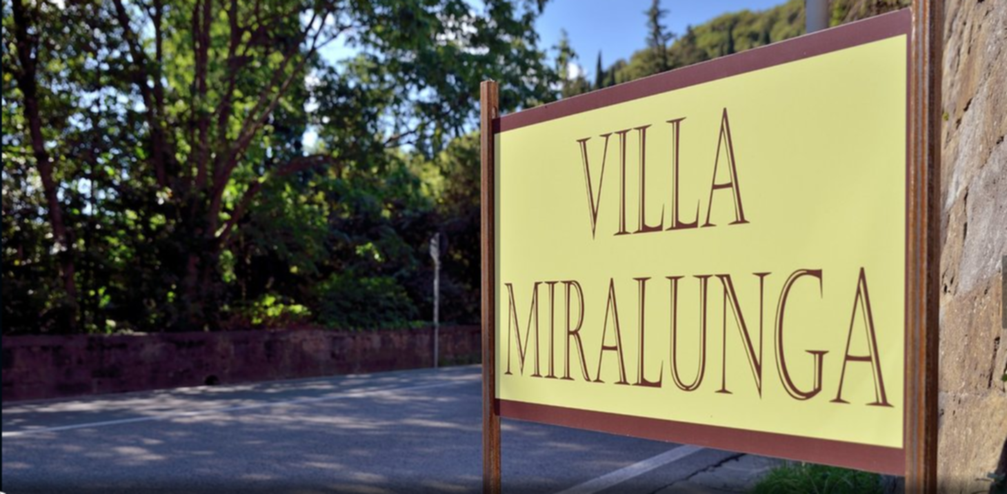 A sign on the side of the street at VILLA MIRALUNGA B&B.