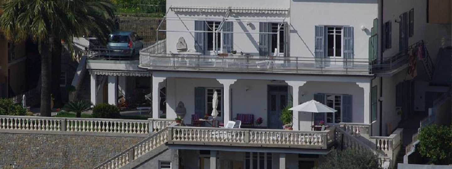 A person standing in front of a building at B&B CAVALLUCCI DI MARE.