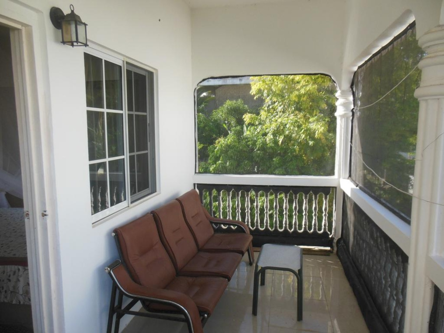A chair sitting in front of a window at Casahun Bed & Breakfast.