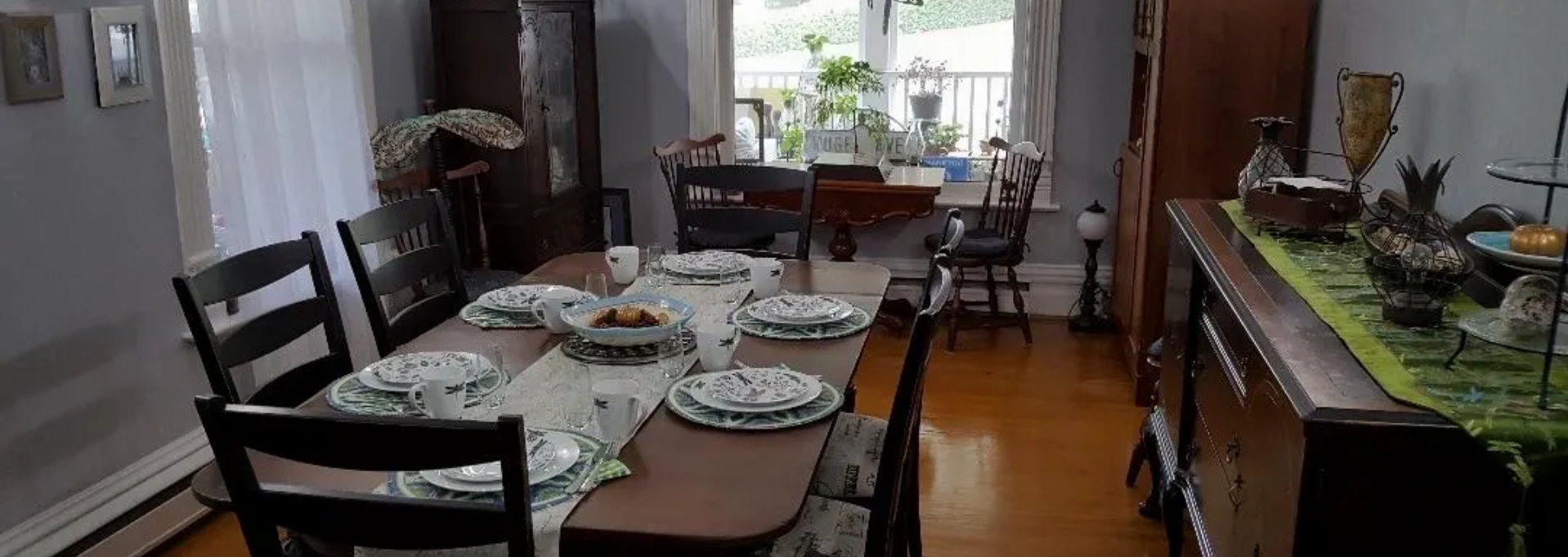 A dining room table at Dragonfly Dreams Inn Bed and Breakfast.