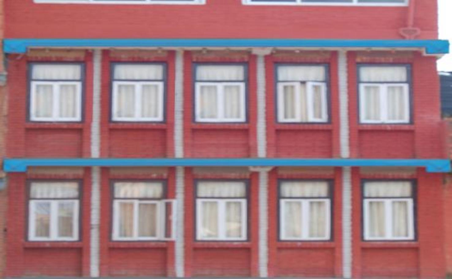 A close up of a brick building at Hotel Visit Nepal.