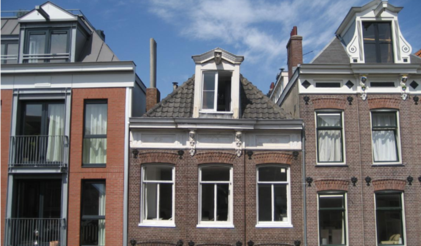A large brick building with many windows at Goodnight Amsterdam.