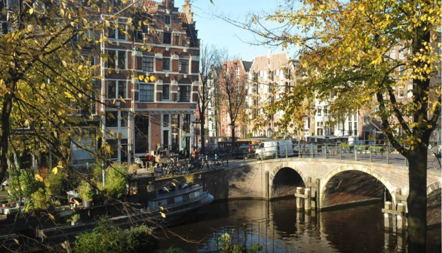 A bridge over a river in a city at B&B The Posthoorn Amsterdam.