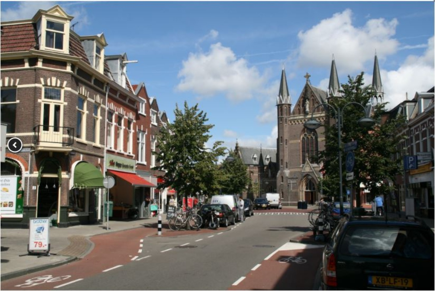 A clock tower in the middle of a city street at B&B Apartment,Little Amsterdam.