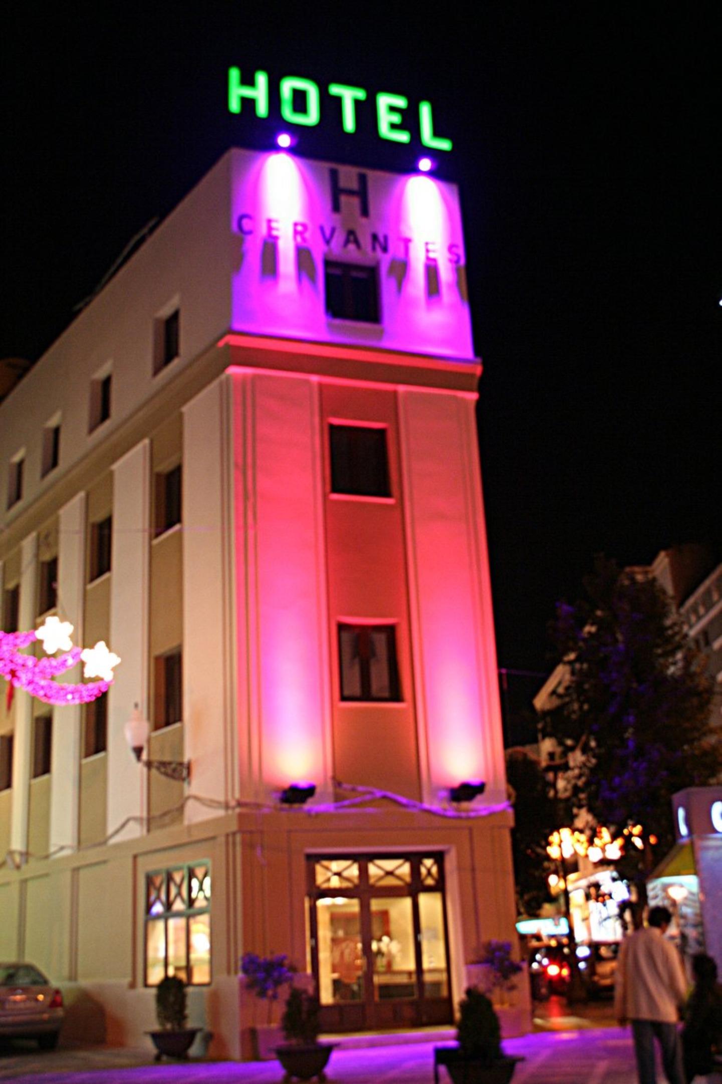 A building with a purple flower at El Cervantes Hotel.