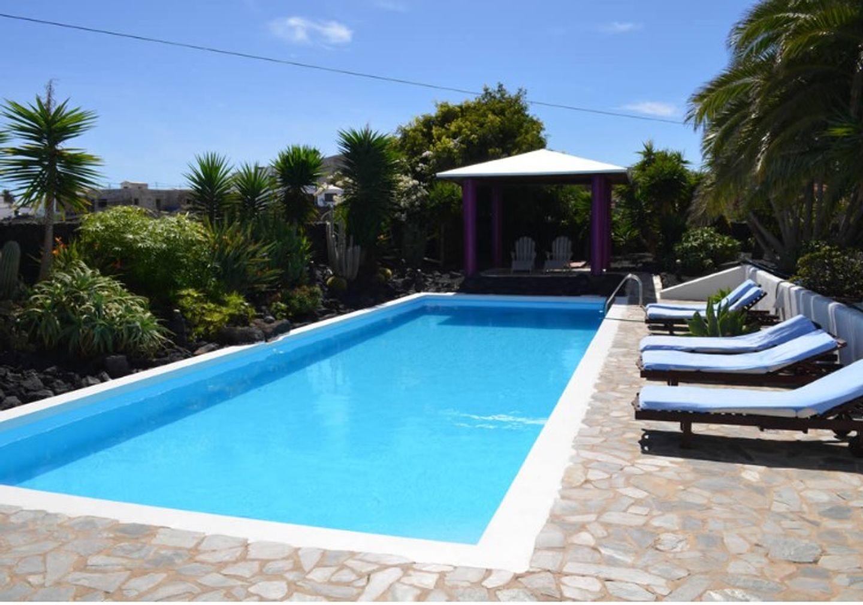 A large pool of water at Villa El Inti.