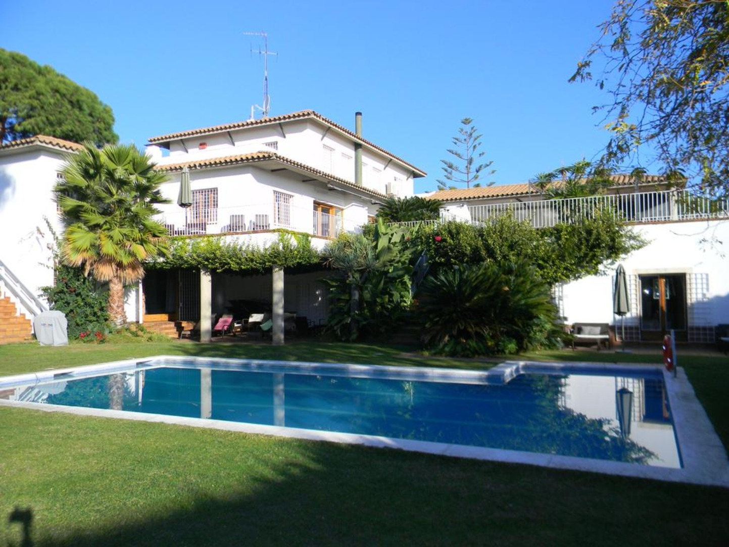 A house with a pool in front of a building at Gavina Mar.