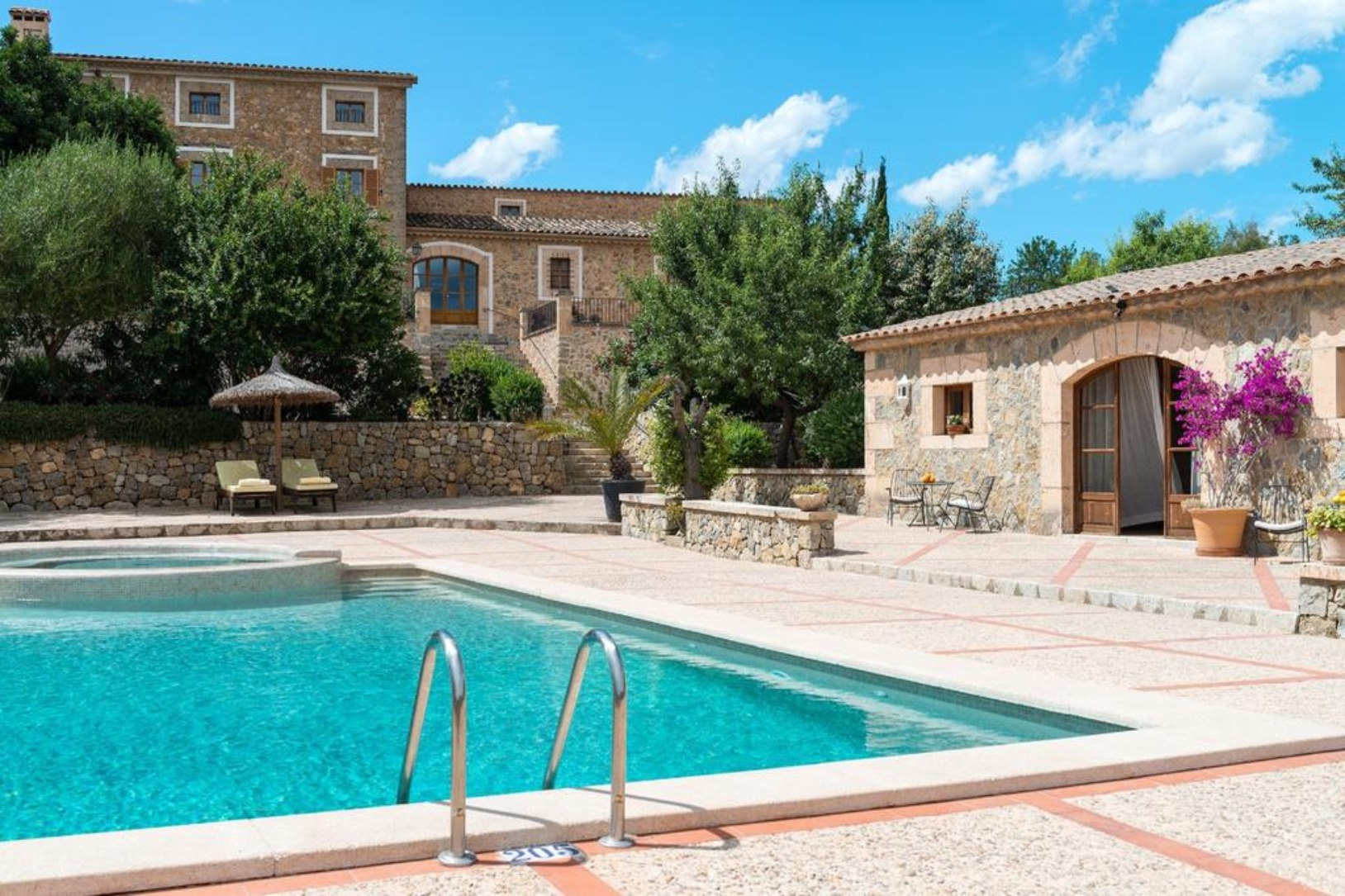 A pool in front of a building at Can Estades.