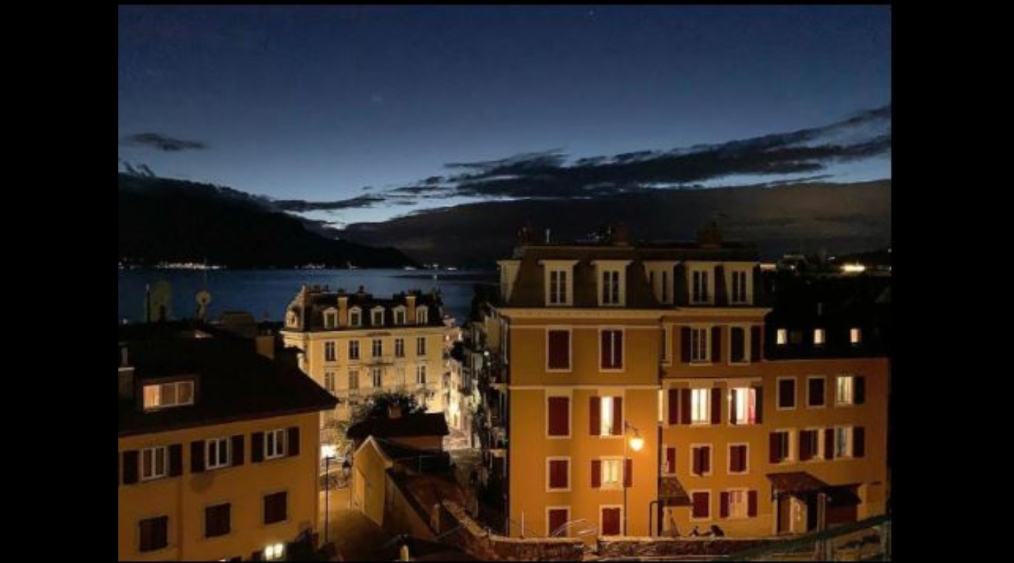 A castle lit up at night at Sunset Montreux, Ideal for 2 people.