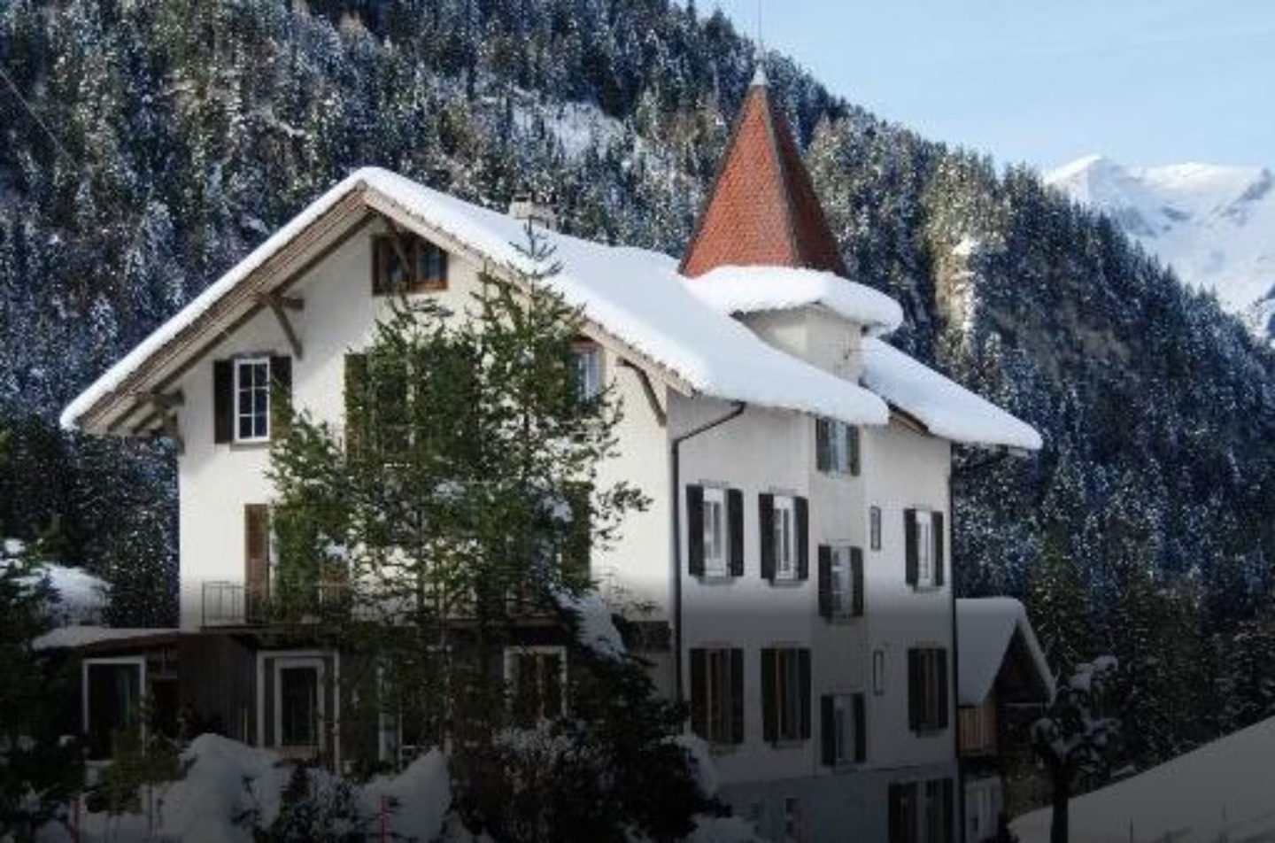 A house covered in snow at Haus Schönegg.