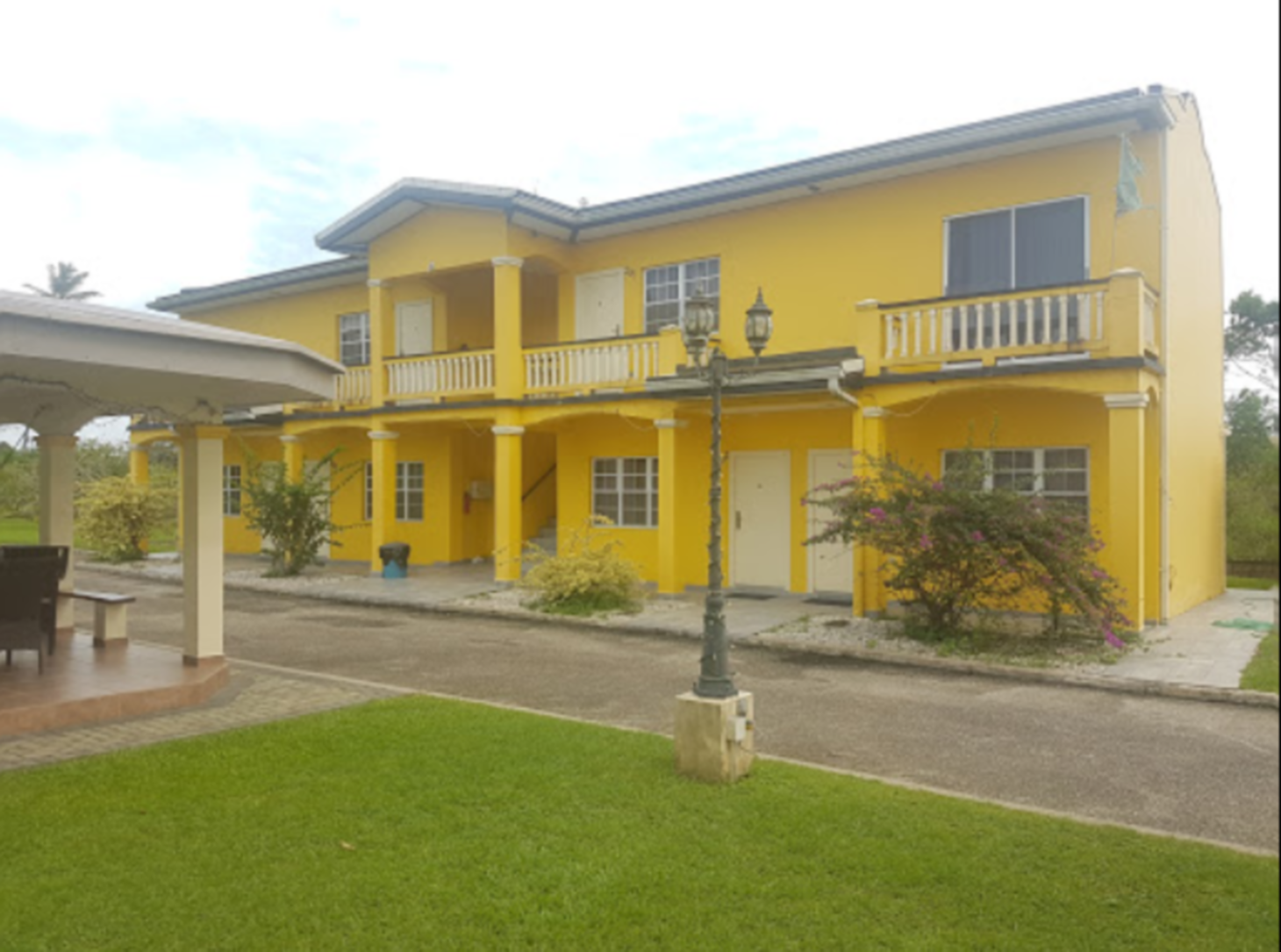 A close up of a street in front of a house at Piarco Village Suites.