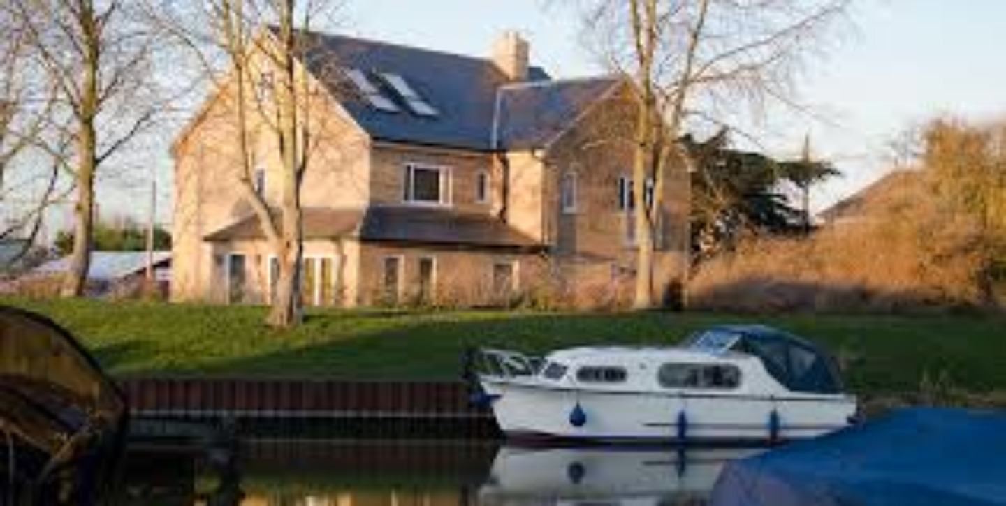 A boat parked on the side of a house at The Gate House.