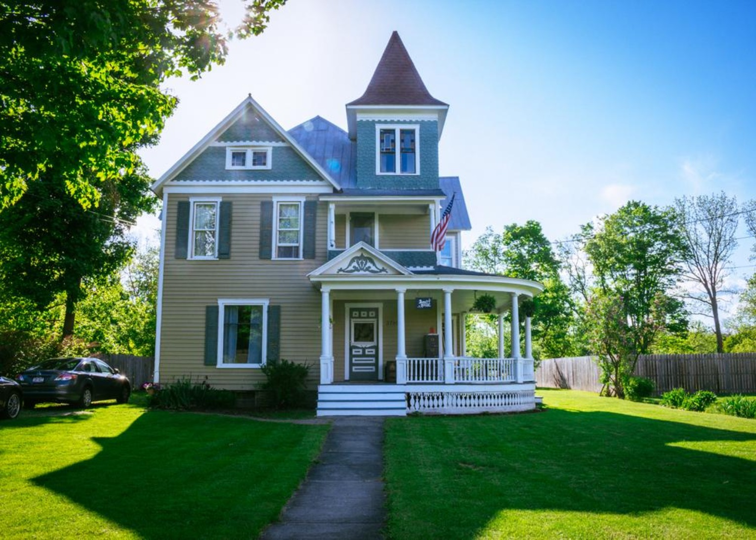 A large lawn in front of a house at Burdett House Bed & Breakfast.