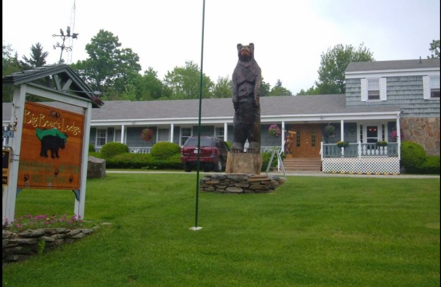 A person standing in front of a house at Big Bears Lodge.