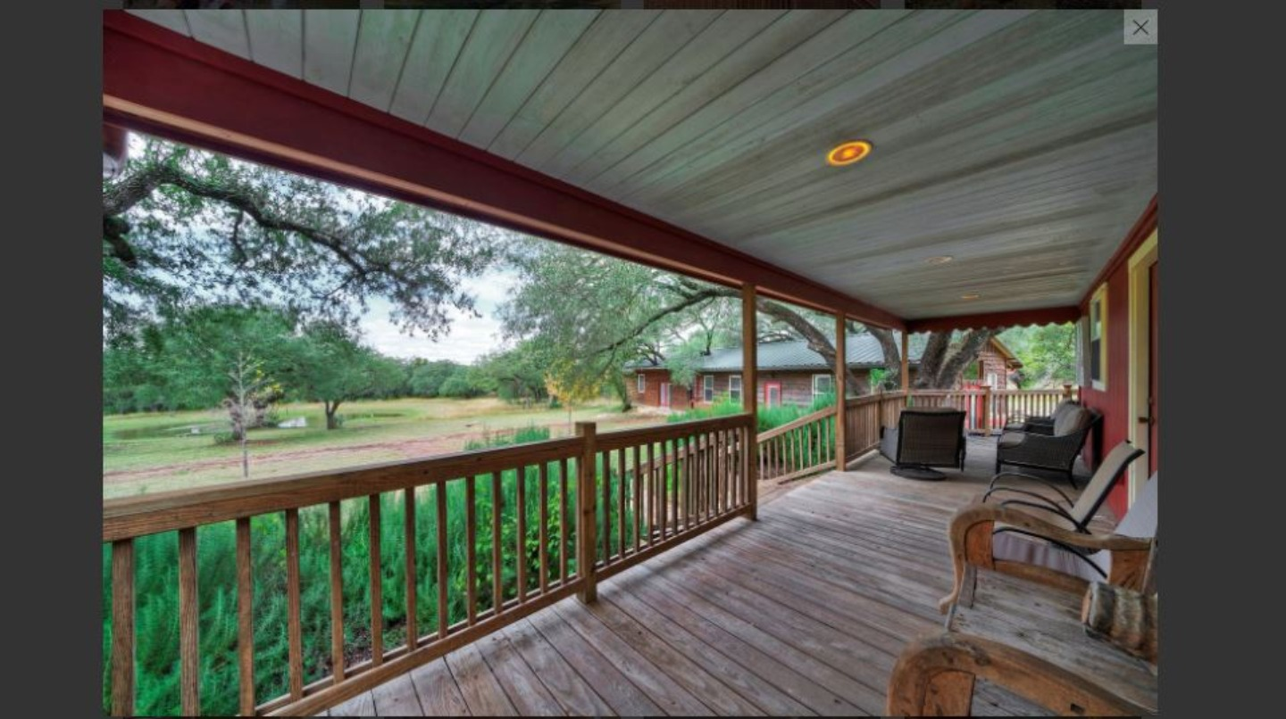 A room with a wooden fence at Hillside Acres Retreat.
