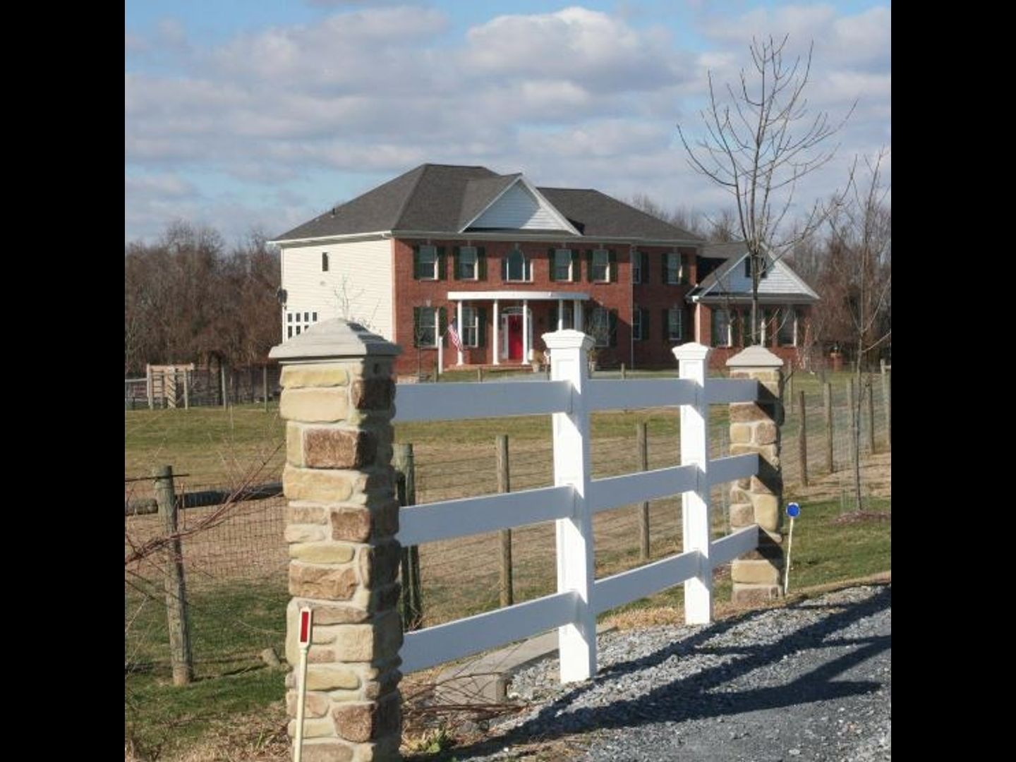 A house with a fence at The Candle House Inn.